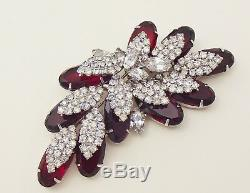 A vintage 1960's unsigned Kramer, ruby rhinestone parure of necklace, brooch and
